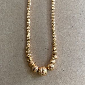 round-beaded style gold-plated necklace